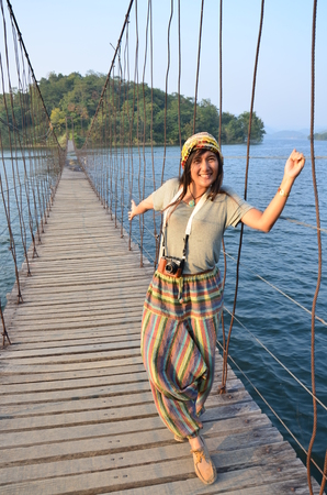 Thai Woman portrait on the bridge at location Kaeng Krachan Dam in Kaeng Krachan National Park at Phetchaburi Thailand   写真素材