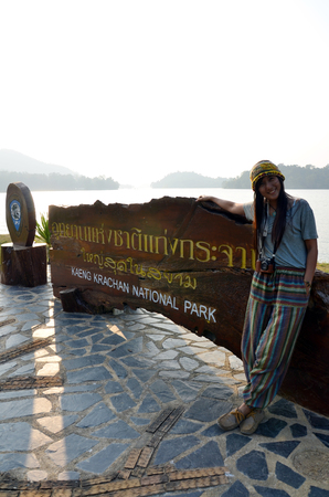 kaeng: Thai Women portrait with Billboard of Kaeng Krachan Dam in Kaeng Krachan National Park at Phetchaburi Thailand Stock Photo