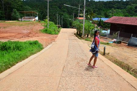 Thai woman stand on street at Phu Hin Rong Kla National Park in Phitsanulok Thailand  photo
