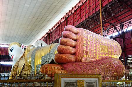 Buddha s foot print with the description of the lives of Chauk Htat Gyi Reclining Buddha Image at Kyauk Htat Gyi Pagoda in Yangon, Burma