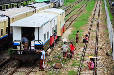 Burmese people waiting train and selling product at railway station in Bago, Myanmar