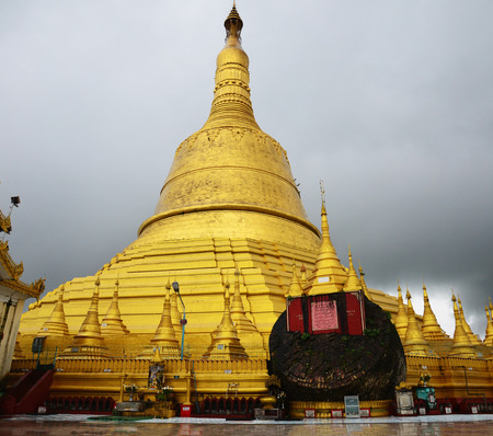 Shwemawdaw Paya Pagoda is a stupa located in Bago, Myanmar  It is often referred to as the Golden God Temple  photo