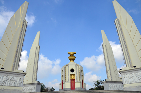 Democracy of Monument and four wing-like structures which guard the Constitution, representing the four branches of the Thai armed forces on Ratchadamnoen Klang at Bangkok Thailand  photo