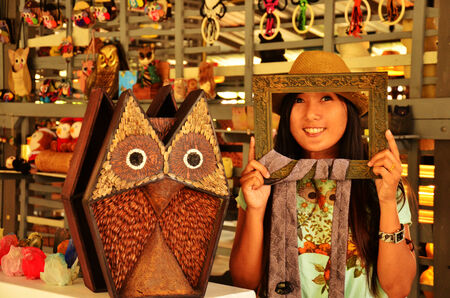 Portrait Thai woman with Owl Doll photo