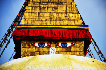 Boudhanath or Bodnath Stupa with Buddha eyes or Wisdom eyes is the largest stupa in Nepal and the holiest Tibetan Buddhist temple outside Tibet  It is the center of Tibetan culture in Kathmandu  photo