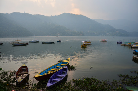 Boats on Phewa Lake in Annapurna Valley at Pokhara Nepal  photo