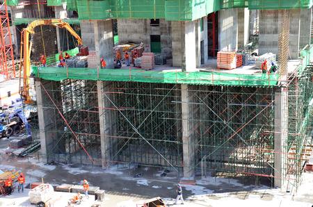 personas trabajando: Las personas que trabajan en la Construcci�n Construir Sitio en Bangkok Tailandia