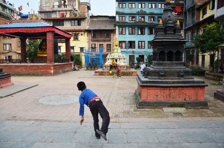 Children Nepalese people playing cricket at Lalitpur Sub-Metropolitan City on November 2, 2013 in Patan Nepal