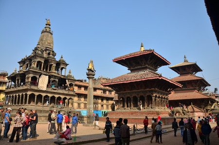 Traveler and Nepalese people come to Patan Durbar Square for travel and pray on November 2, 2013 in Patan Nepal