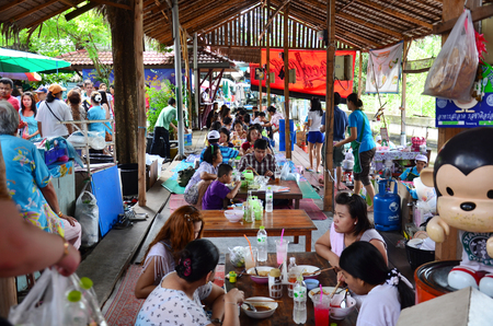Thai people go to Bangnamphung Floating Market for travel and shopping on August 10, 2014 in Samudprakarn Thailand