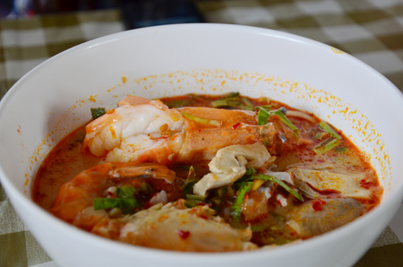Tom yum goong seafood recipe or Thai Seafood Spicy Soup photo
