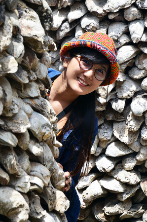 oyster shell: Thai women portrait with Oyster Shell wall in Wat Chedi Hoi, The Oyster Shell Temple located in of Pathum Thani Province, central Thailand.