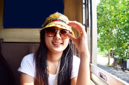 Traveler Thai woman on Railway Train start at Bangkok go to Phra Nakhon Si Ayutthaya at Thailand photo