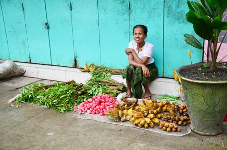 Burmese Woman selling fruit and vegetable at Oxen Market on July 12, 2014 in yangon Myanmar