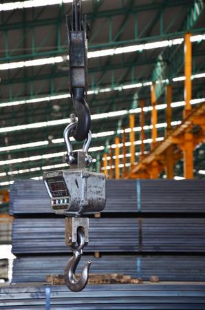 Crane and Weight balance Machine in Steel warehouse photo