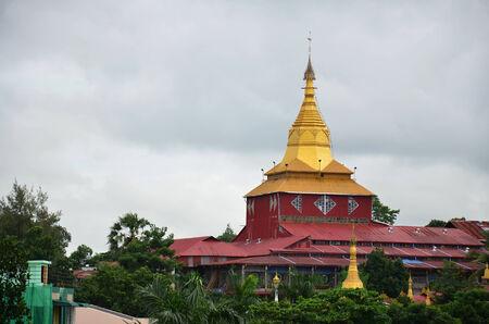 Kyauk Htat Gyi Pagoda with clouds stromy in Yangon, Burma.