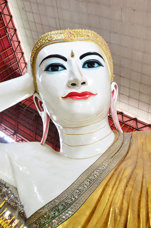 Kyauk Htat Gyi Reclining Buddha or Chauk Htat Gyi Reclining Buddha Image at Kyauk Htat Gyi Pagoda in Yangon, Burma. 写真素材
