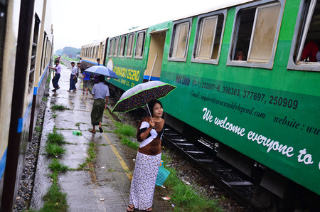 Burmese people waiting train at railway station on July 13, 2014 in Bago, Burma.