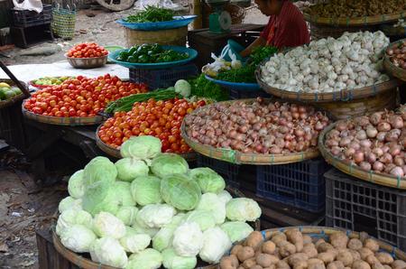 Burmese Woman selling fruit and vegetable in Bago market Myanmar
