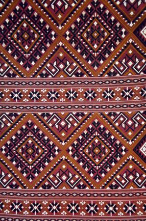 Thai art on Fabric texture, cloth background Thai Style photo