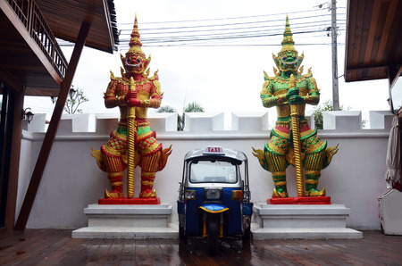 Thailand Motor tricycle or tuktuk with Carved and sculpture giant guardian