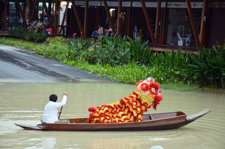 The Lion dance parade on boat is performed by a pair of dancers. They represent protection. Statues of lions are used to guard palaces and other buildings.