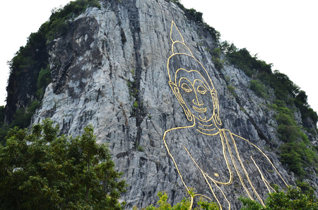 Buddha Mountain, which is also called Khao Cheejan or Khao Chee Chan or officially called Phra Phuttha Maha Wachira Uttamopat Satsada. The Buddha image was carved by laser beams in Pattaya Chonburi. photo