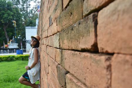 Thai woman portrait at Brick wall Background in Kanchanaburi Thailand. photo