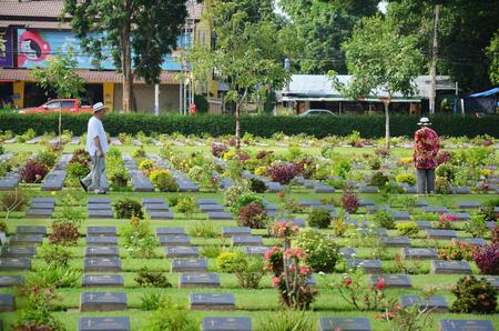 Traveler foreigner visit Kanchanaburi War Cemetery (Don Rak) on  November 1, 2014 in Kanchanaburi Thailand.