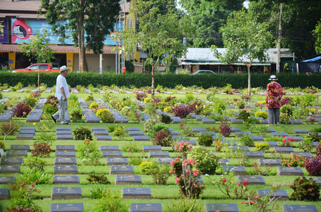 foreigner: Traveler foreigner visit Kanchanaburi War Cemetery (Don Rak) on  November 1, 2014 in Kanchanaburi Thailand.