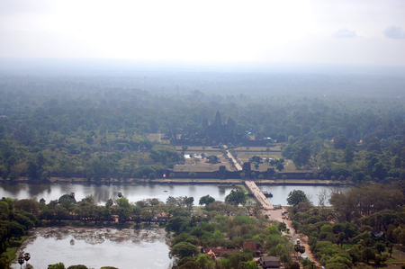View on top of Angkor Wat in morning. Angkor Wat was first a Hindu, later a Buddhist, temple complex in Cambodia and the largest religious monument in the world. photo
