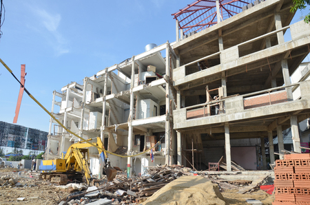 demolish: Machine for Demolish or Pull Down Building Structure in Thailand Stock Photo