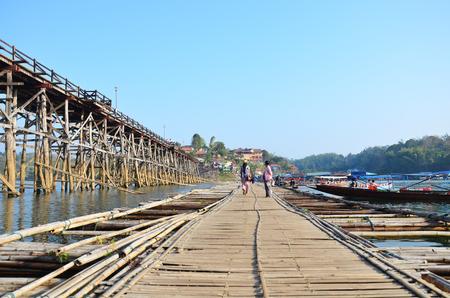 Antique bamboo bridge connecting the main part for use instead Saphan Mon Broken bridge of Songkhla Buri Kanchanaburi Thailand. photo