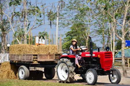 Thai Women portrait on Tractor trailer machine with Rice straw Bale 写真素材