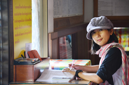 Thai women write memory on book. photo