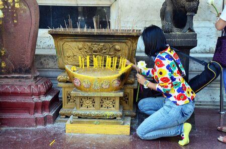 wat bowon: Thai Woman praying at Wat Bowonniwet Vihara, or Wat Bowon located on Bangkok Thailand.