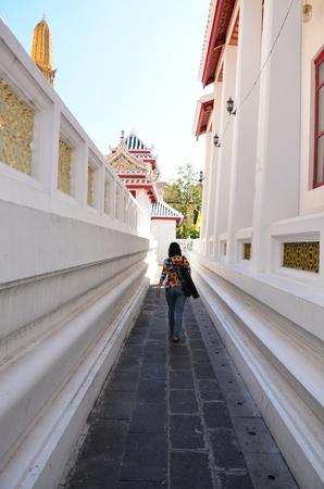wat bowon: Thai woman walking at Wat Bowonniwet Vihara, or Wat Bowon located on Bangkok Thailand.