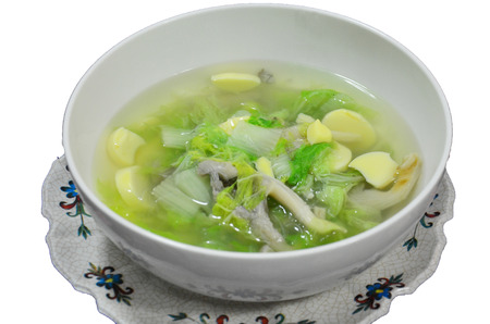 mild: Cooking mild soup with vegetables, pork and bean curd Stock Photo