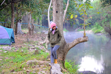 Thai woman portrait in morning of winter season at forest and stream or canal of Suan Phueng District in the western part of Ratchaburi Province, central Thailand. photo