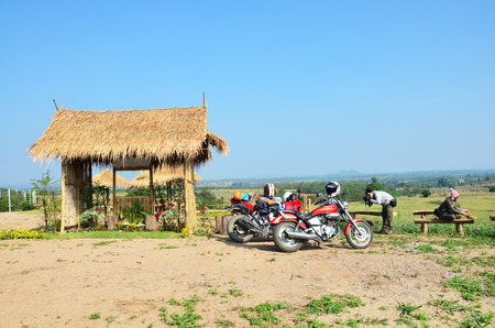 ratchaburi: Traveler stop Sport Motorcycle and Chopper Motorcycle for rest at Viewpoint in winter season at Ban Kha is a district in the western part of Ratchaburi Province, central Thailand.