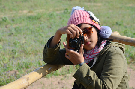 Thai woman take photo on Viewpoint in winter season at Ban Kha is a district in the western part of Ratchaburi Province, central Thailand. photo