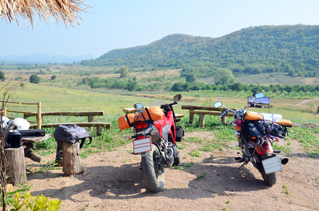 Stop Sport Motorcycle and Chopper Motorcycle for rest at Viewpoint in winter season at Ban Kha is a district in the western part of Ratchaburi Province, central Thailand. photo