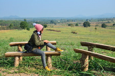 ratchaburi: Thai woman sit for rest at Viewpoint in winter season at Ban Kha is a district in the western part of Ratchaburi Province, central Thailand.