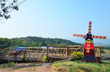 Pin wheel or windmill on Viewpoint in winter season at Ban Kha is a district in the western part of Ratchaburi Province, central Thailand. photo