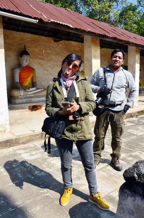 Portrait Thai man Photographer and woman Photographer in Aranyikawas Temple at Ratchaburi Thailand photo