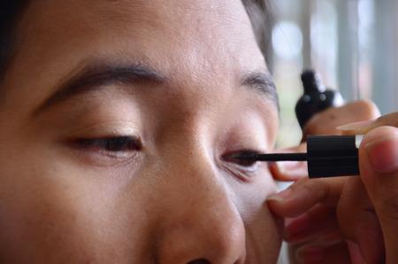 Make up Lifestyle Thai woman use eyeliner photo