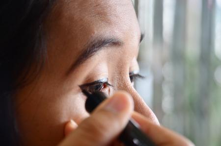 Lifestyle Thai woman use eyeliner photo