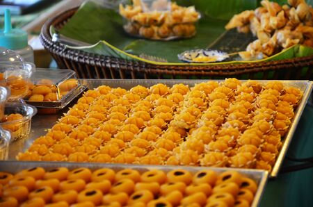 jah: Nine auspicious Thai desserts name JAH MONGKUT - looks like a crown topped with a piece of gold leaf. The meaning is to have command and superiority in the career.