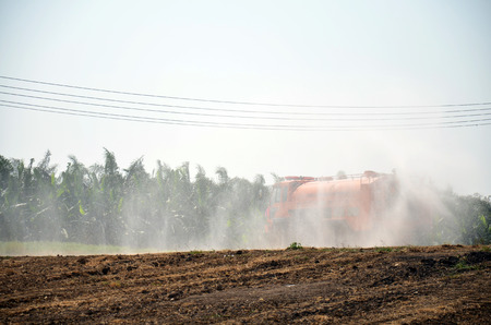 wetting: Water Truck spray to ground for protect occur dust at pond occur from excavation of the surface ground for Sale in Pathum Thani at Thailand