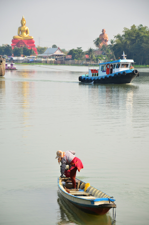 Culture and Tradition Life of Thai People around Chao phraya river near Wat Bot Temple in Pathum Thani Thailand photo